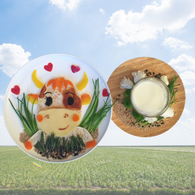 Happy Dutch Cow made from leafy vegetables, bell peppers, wraps, tomatoes, seaweed, and there is milk on the side.